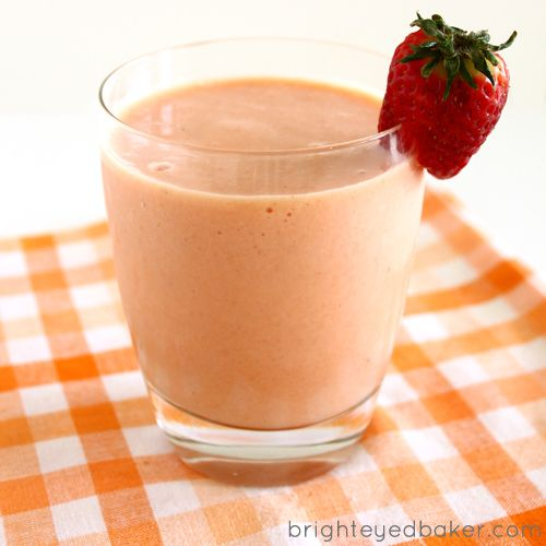 Berries and Mango Smoothie (1 mango, peeled, pitted, and sliced   4 small or 2 large strawberries, hulled   1 cup raspberries   1 navel orange, peeled   1 meyer lime, peeled   4 small or 2-3 large ripe bananas   1 1/2 cups milk   28 large ice cubes   4 strawberries, for garnish)
