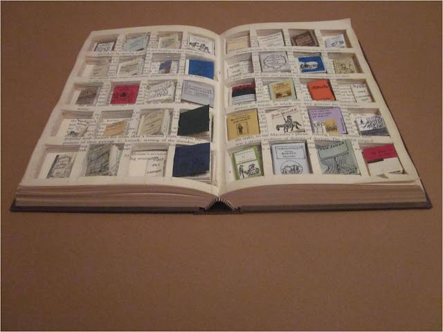 Miniature books within a book.  Wow!               Gloucestershire Resource Centre http://www.grcltd.org/scrapstore/