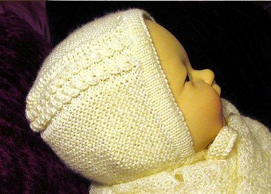 Princess Bonnet Free Knitting Pattern | Royal Family Knitting Patterns | This baby bonnet was designed by Rian Anderson after the bonnet the new baby Princess Charlotte wore in her public debut