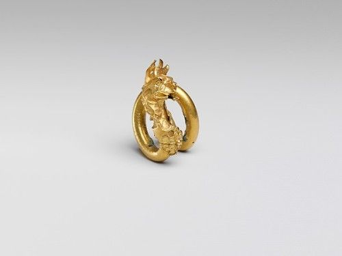Gold spiral with a griffin  Most likely this spiral was used as hair decoration. 3.8cm long (1 ½ inch)  Cyprus, Classical Period, 400 - 350 BC.  Source: Metropolitan Museum