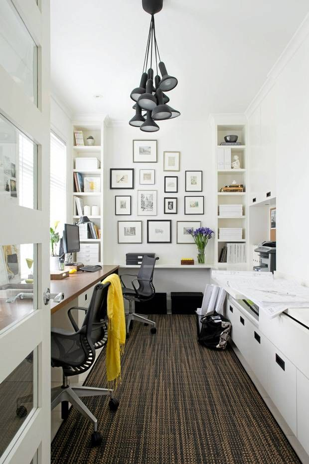 What a great-looking home office--fabulous use of an awkward-sized room.  The photo grouping on the end wall draws the eye in, as does the rug.  The color scheme gives the space a sense of calm in an area that can be cluttered.  LOVE the light fixture and the door!
