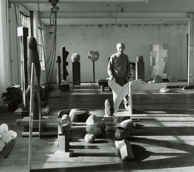 Isamu Noguchi with sculptures in his Long Island City studio, 1980. Photo by Al Mozell.