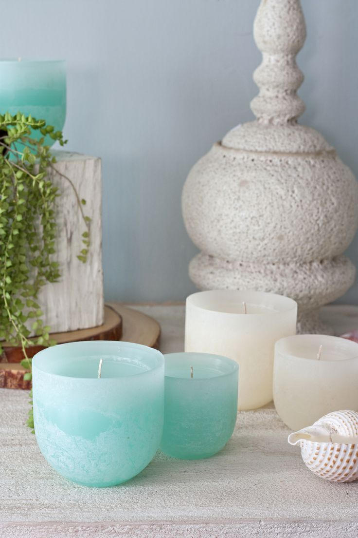 Timber Luminaries- Glowing luminaries in a Timber Texture. A lower level of wax creates the effect and tapered edges enhance the disbursement of light. Perfect for summer in Turquoise & Melon White!