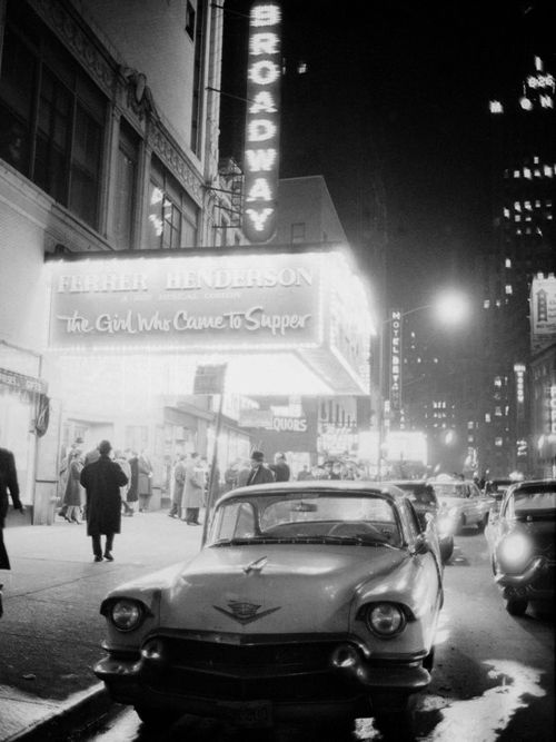 neon signs at night time on broadway, new york, 1950s    photographer unknown