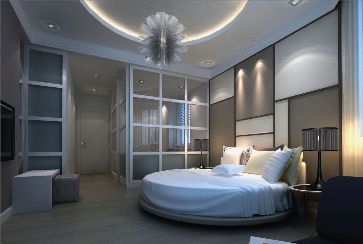 Multi-tone bedroom design in blue, grey and white with circular bed and glass screen wall