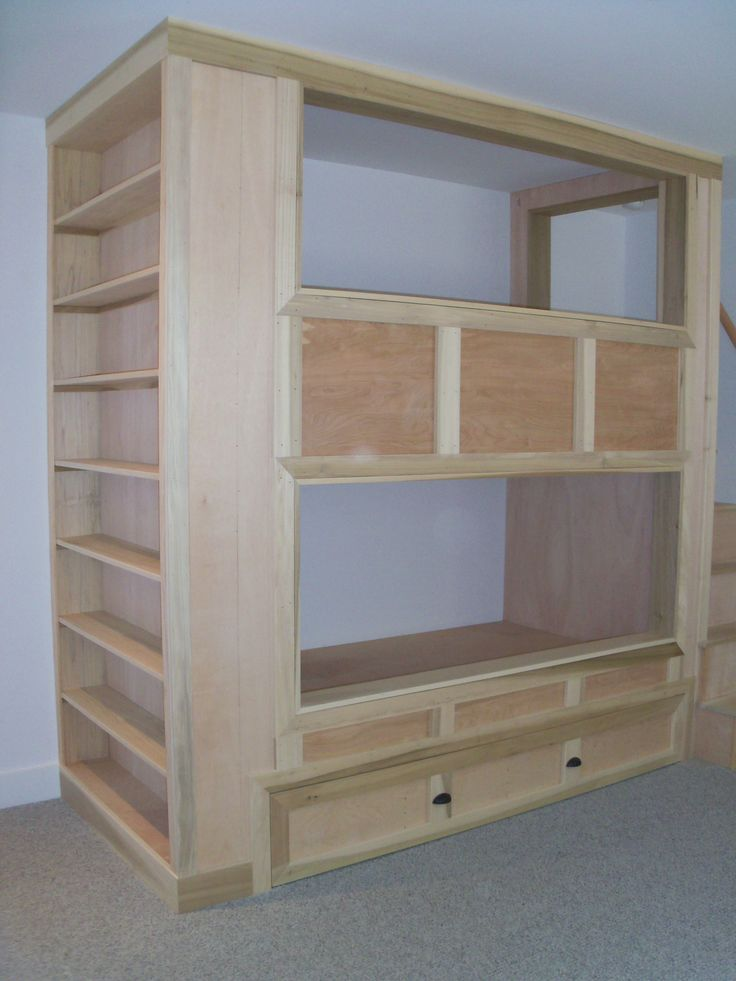 Built in bunk beds with bookshelves and pull-out trundle bed 3