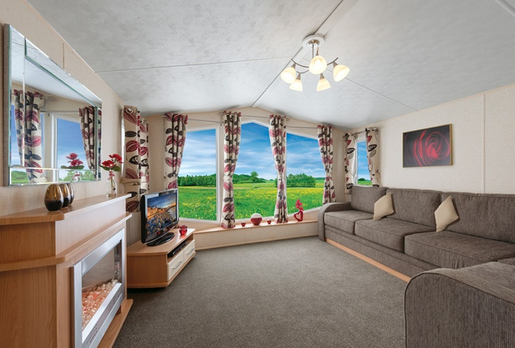Wall art, TV and DVD player not included. Scatter cushions optional extras