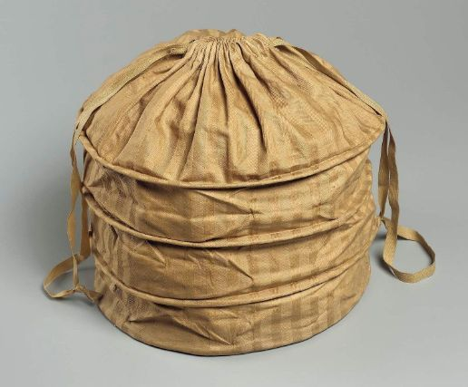 Bonnet bag  French, used in America, mid-19th century  PLACE OF USE  Boston, Massachusetts, United States  PLACE OF MANUFACTURE  France  DIMENSIONS  Overall: 38.7 x 33 cm (15 1/4 x 13 in.)  MEDIUM OR TECHNIQUE  Cotton twill, wool twill, wood  CLASSIFICATION