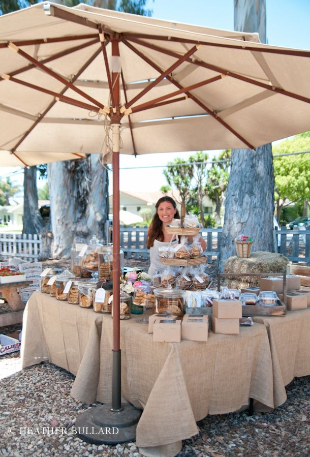 use a patio umbrella instead of a canopy for M's farmer's market stand.
