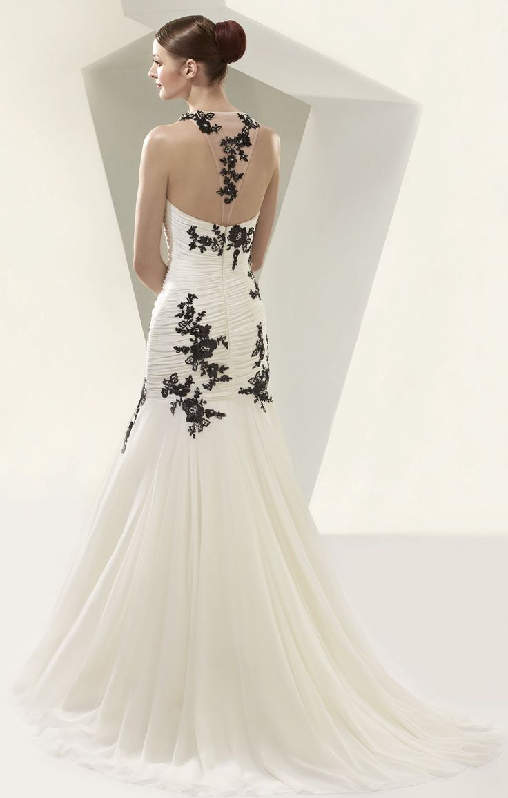 Black sequins on Ivory gown, stunning. available at Mia Boutique