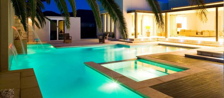 swimming pool Luxury Lap Pool Design With Mini Waterfall Decoration And Small Square Jacuzzi Pool How to build lap pools into your house