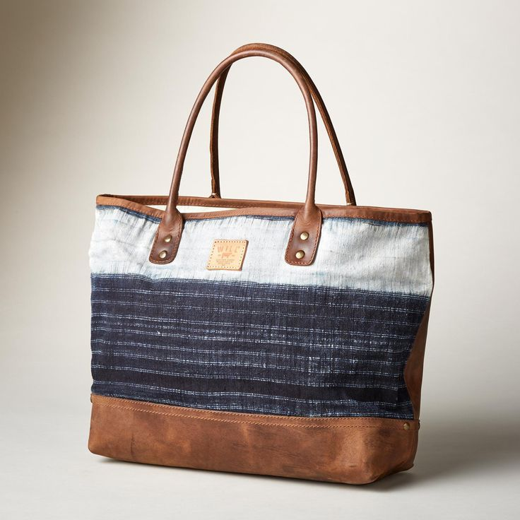 """BATIK TOTE--This Will Leather Goods® tote bag breathes new life into found batik fabric and vintage tanned leather to bring you a classic tote to stand the test of time. Each is unique. Imported. Approx. 20-1/2""""W x 6-1/2""""D x 13-1/2""""H."""