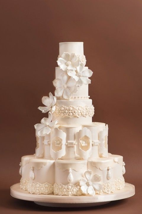 ivory wedding cake with sugar blossoms & pearls