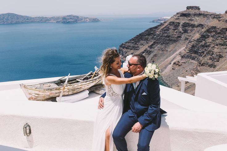 #wedding #weddingphotography #weddingideas #unfogetable #moments #old #boat #hug #white #dress #flowers #bride #groom #oia #santorini #ios #folegandros #mykonos #miltoskaraiskakis