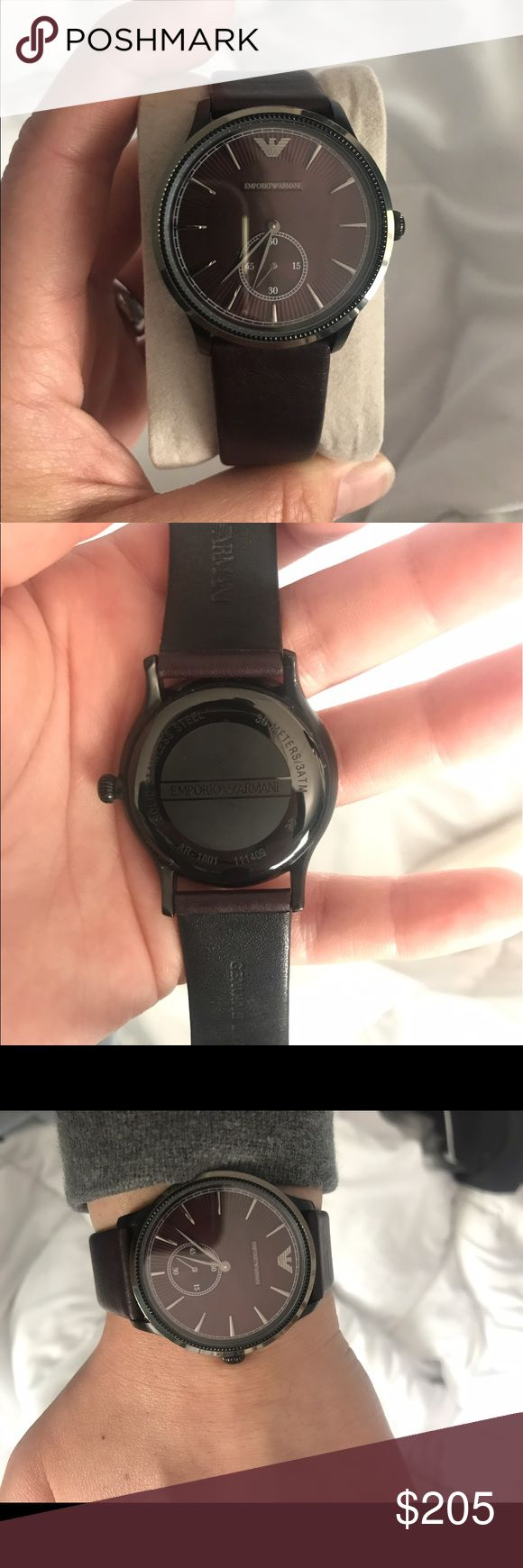 Emporio Armani Aubergine watch. AR1801. Classic burgundy three hand Emporio Armani watch. 38MM and thin at 10.5mm 3ATM resistant. If you want more pictures/video shoot me your email with a description of what you want to see. Price is negotiable. Emporio Armani Accessories Watches