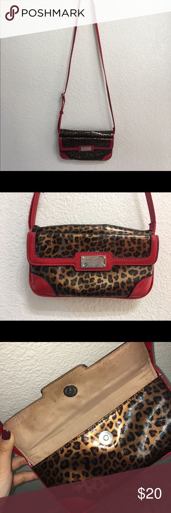 Over-the-shoulder Nine West Purse Cheetah print with red embroidery; used about 4 times when going out! Nine West Bags Shoulder Bags