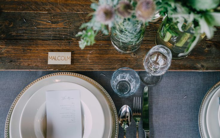 Adorn Event Styling@Tailrace Centre.  Rustic wood textures, glass ware and green foliage.