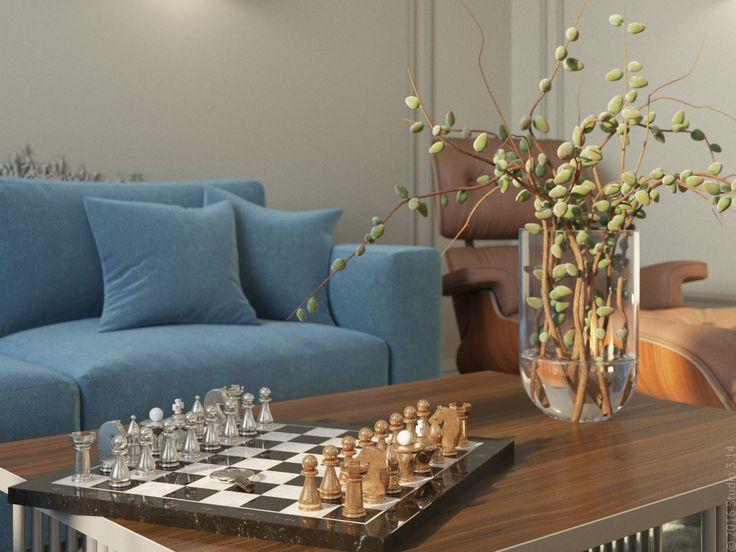 Журнальный столик из дерева и металла стоит на голубовато-сером ковре.