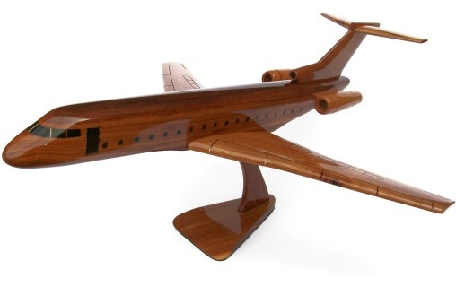 """A beautiful hand carved desktop model of the Boeing 727. The model has been carved from solid mahogany. The model comes boxed and is simple to assemble. The wings, tail fins and stand simply slot into pre-drilled holes on the body of the aircraft. No glue required. Size H 9"""", L 20"""", W 18"""". Visit our website at thewoodenmodelcompany.co.uk to view the full range of our models."""