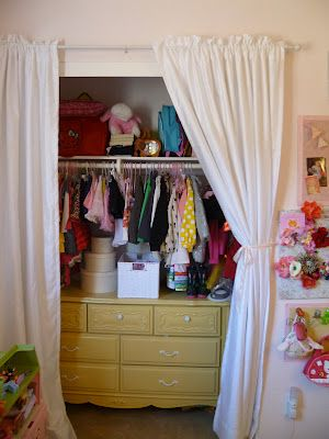 open closet with dresser in closet  might be good when kids have to share a room to give more room :)