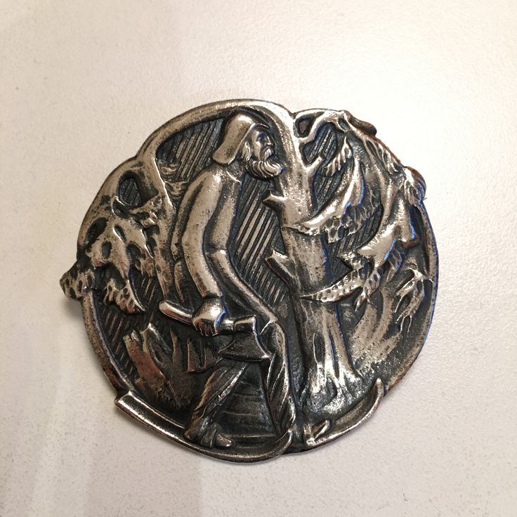 Gustav Gaudernack design for own workshop. Silver brooch with motif from viking saga. Skier in witrer wood.  1910-1914