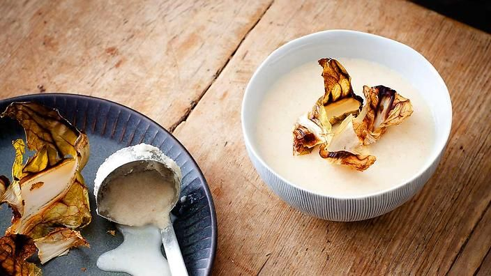 Baked cauliflower & juniper soup | The lesser-practised technique of roasting cauliflower whole brings out a distinctly different flavour, one that is nutty and more caramel-like. It is enhanced in this recipe by brown butter and fragrant juniper. Adding the cream is optional. Enjoy with some rye bread or buttered crispbread on a cold day.