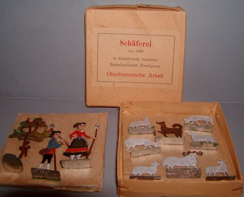 Shaferei. ca. 1830 German farm figures in original box. Tree with 3 birds and squirrel. Shepherd blowing horn. Woman standing with staff. Brown dog. Ram and 6 sheep. (toytoycj/eBay)