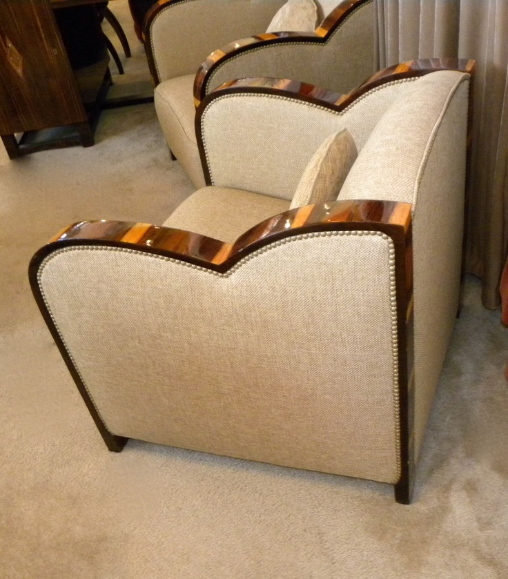 side view of pectacular ornate wood framed Art Deco club chairs