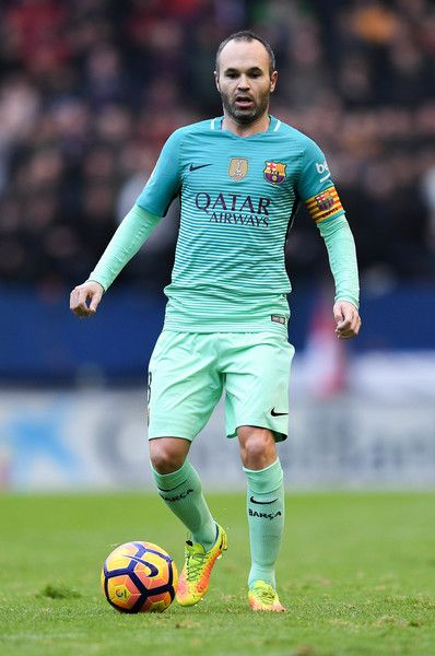 Andres Iniesta of FC Barcelona runs with the ball during the La Liga match between CA Osasuna and FC Barcelona at Sadar stadium on December 10, 2016 in Pamplona, Spain.