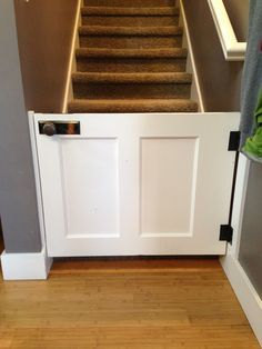 How to Make a half door From an Old Wood Door. Looks so much nicer than the other gates!!