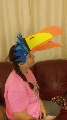 Mrs. Reyes modeling Zazu head piece.