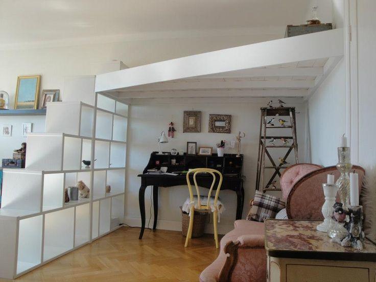 A white painted Mezzanine Loft with steps designed as a bookshelf  We can help you improve your existing space with our unique bespoke Mezzanine lofts Scandinavian Loft design by Per Martenson
