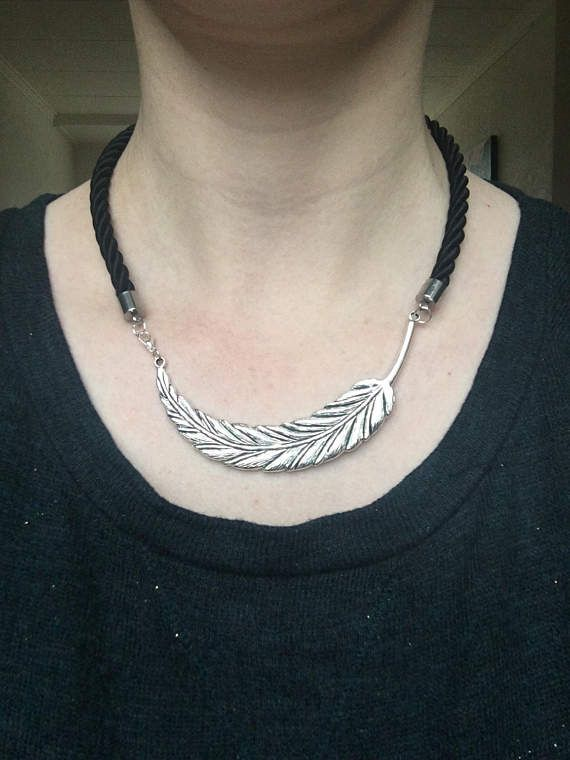 Short statement necklace made of rope, black twisted silk cord with a big feather or leaf pendant