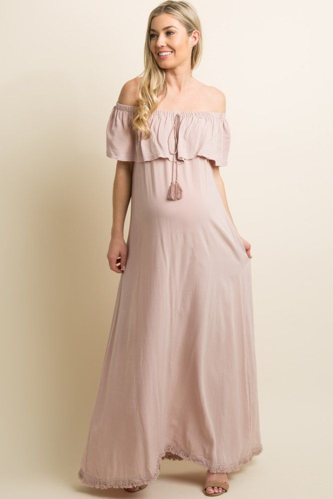 51d40a79915 A solid hued linen maternity maxi dress featuring a cinched off shoulder  neckline with a slit
