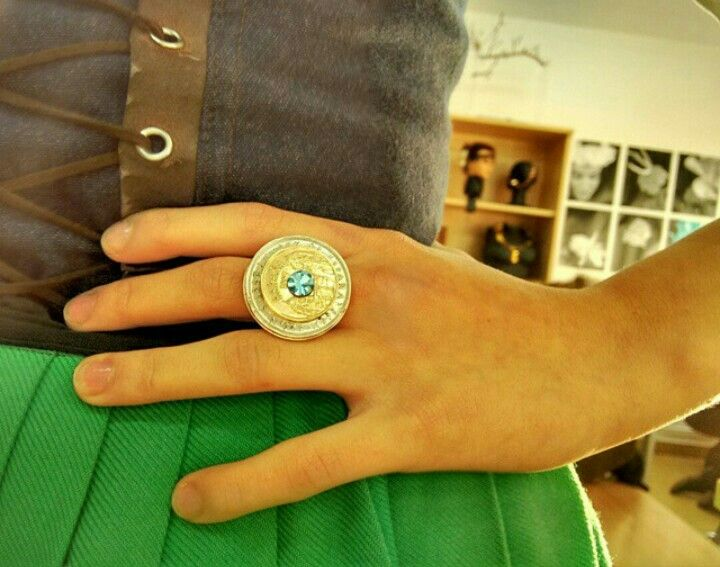 """Silver ring with old coins """"pesetas"""" and blue swarrosky crystal. Made by Sara Alonso."""