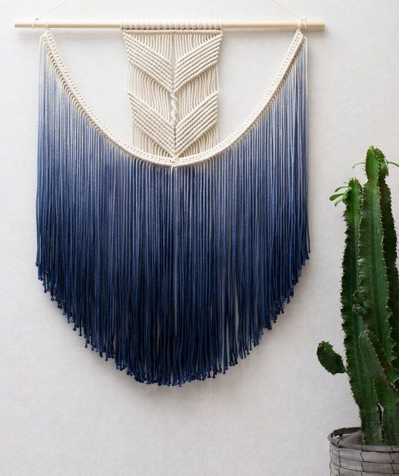 This gorgeous handmade macrame wall hanging is handmade with neutral and hand-dyed navy blue cotton macrame cord.  With this macrame wall hanging youll instantly add a bohemian vibe to your room an it will really warm up a space. ------------------------------------  This macrame wall hanging measures:  Wooden dowel length- 71 cm ( 28 inches ) Macrame width: about 65 cm ( 25.5 inches ) Macrame height: about 85 cm ( 33.5 inches )   This item is made to order. It takes 14 days to make this…