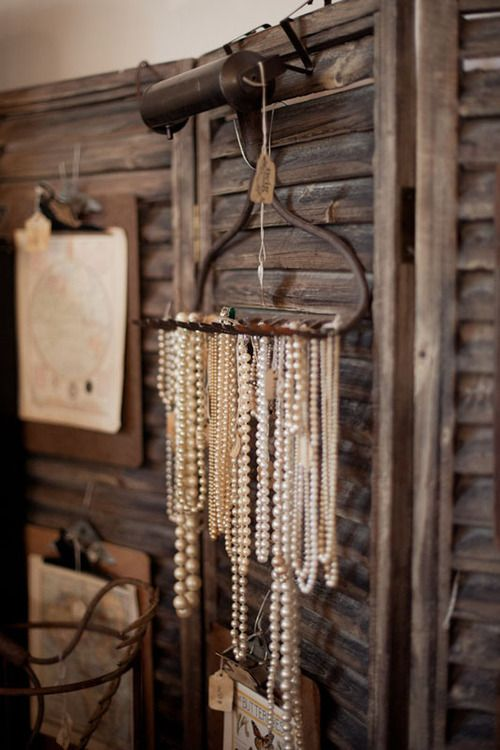 this would be great. The window blinds with the rake hanging off. Also, the clip board with a few small hooks at the top for a few necklaces.