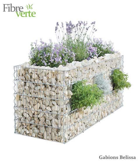 Gabion wall with planters.......bougainvillea could cascade down the wall. It would provide privacy and the bougainvillea thorns would help with security.