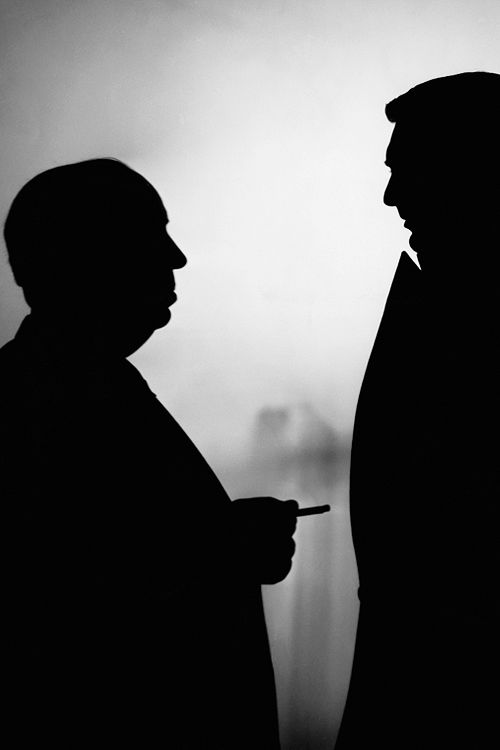 : Silhouettes of Alfred Hitchcock and Cary Grant on the set of Notorious, 1946.