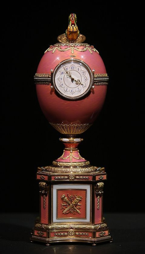 Fabergé gold pink enameled egg was unknown to experts until it was consigned to the auction house by an unnamed member of the Rothschild banking dynasty.Made by Karl Fabergé in St Petersburg in 1902 as a Rothschild wedding gift it's the 2nd largest egg Fabergé made; its face is a clock it contains a multi-coloured, diamond-studded cockerel. Every hour, for 15 seconds, it pops up from inside the egg, flaps his wings 4 times, nods his head 3 times while opening shutting his beak crowing