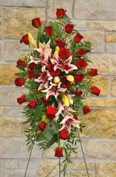 Easle of red roses and stargazer lilies.