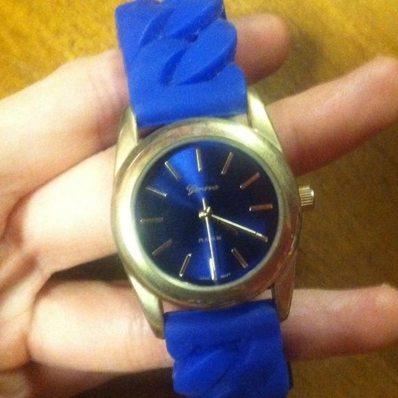 Blue and Gold Geneva Watch Never worn. My wrist is really small and there's still a little room for the watch to move but I wouldn't recommend it for women with larger wrists. Jewelry Bracelets
