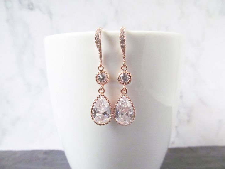 Rose gold crystal earrings. The rose gold earrings are perfect for the bridal earrings for the bride who loves something simple but with a cubic zircon sparkle that make them really standout. They design is perfect for weddings, proms and special occasions. They made a lovely gift for wives, mother of the bride and bridesmaids. The earrings made with rose gold plated teardrop pendant attached to a zircon connector and zircon encrusted ear hook.
