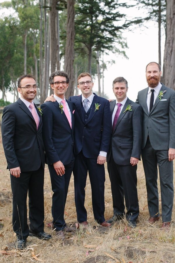 Mismatched groomsmen. Impressive beard. Grooms wear their own suit -- similar color swatch, like bridesmaids