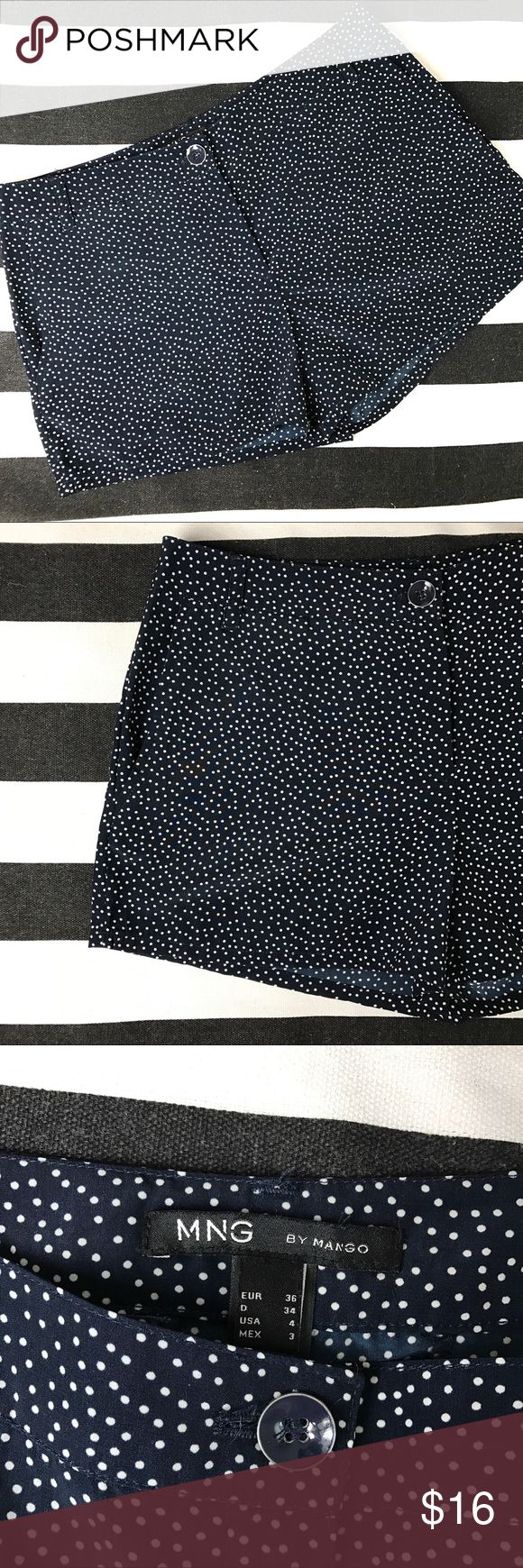 "MNG by Mango Navy Polka Dot Shorts MNG by Mango Navy Polka Dot Shorts. 11 1/4"" long. 3 1/4"" inseam. Front zipper with enamel button closure. Front side pockets and back slit pockets. Belt loops. These shorts are light weight and a silky Polyester blend. Excellent condition. Size 4. Mango Shorts"