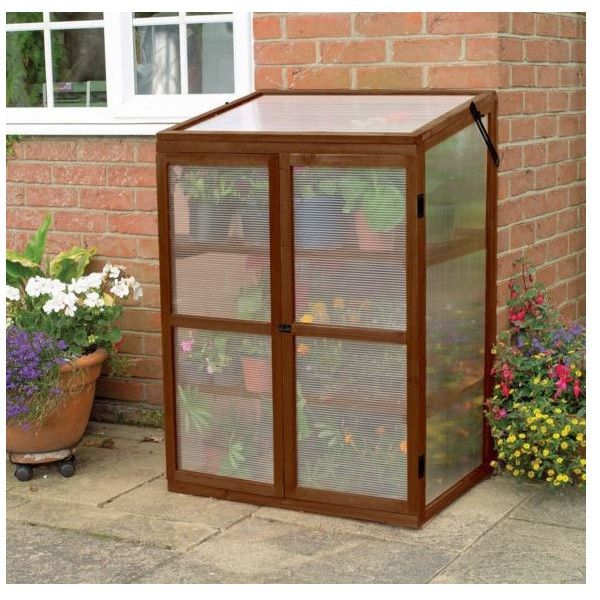 Freestanding Portable Greenhouse Product Description: This lovely plant stand greenhouse structure has all you need to protect your cuttings and seedlings from the cold while still enabling them to gr