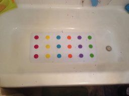 The Munchkin Dandy Dots Bath Mat has colorful, raised dots that keep your baby from sliding around--especially useful when he begins to stand-- and suction cups to keep it securely attached to the bath. (Note that if your tub is textured, the suction may not stay flat.)