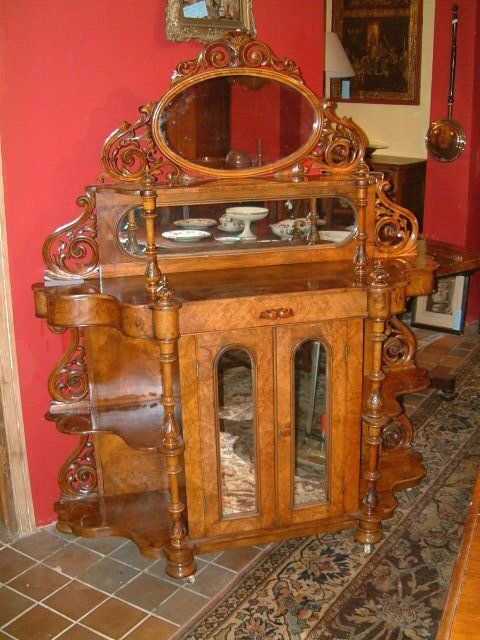 Victorian figured walnut sideboard with mirrored back and doors.