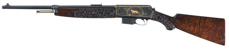 John Ulrich engraved Winchester Model 1910 semi automatic rifle.