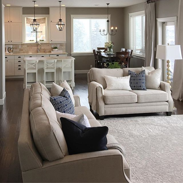 Neutral Decor with pops of blue. Gray walls, dark flooring Greige decor. Sherwin Williams Intellectual Gray & Alabaster!